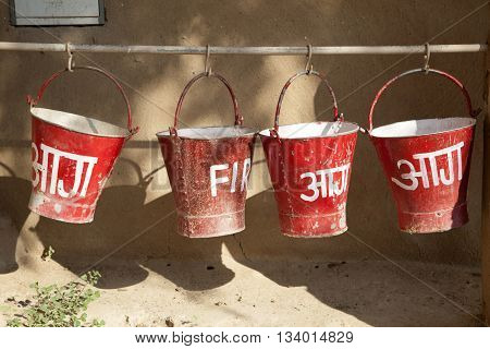 red fire buckets filled with sand to protect in case of fire