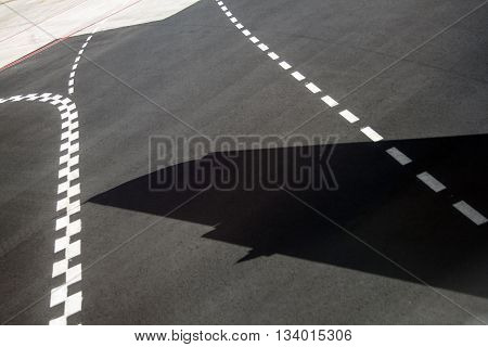 detail of runway at takeoff with white median stripes