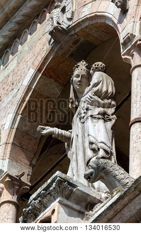 14th century statue portraying the Madonna with Child on the upper loggia of the Cremona Cathedral