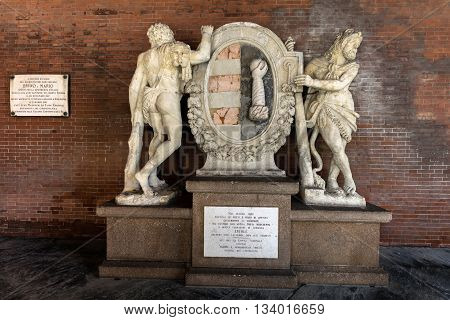 CREMONA ITALY - APRIL 26 2016: Loggia dei Militi (Soldiers Loggia) built in 1292 contains two figures of Hercules the city's mythical founder holding the coat of arms of Cremona