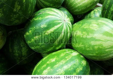 close up on stack of fresh watermelons background