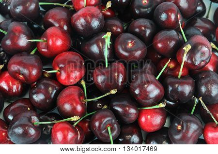 close up on cherries background for design