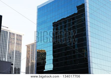 office building reflecting in the blue glass wall in Washington DC