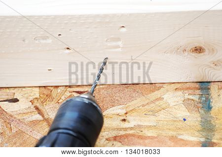 close up on working with electric drill