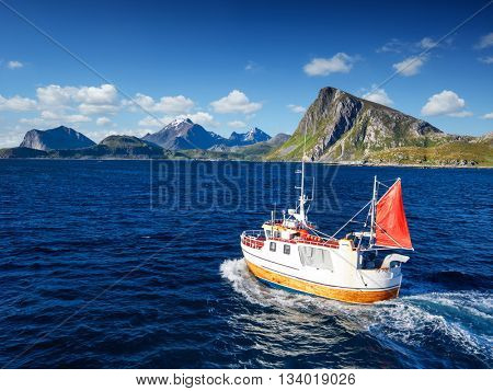 Fishing boat in Norway fjord - sea in lofoten nature. Norway finshing. Norway boat. Norway ocean.