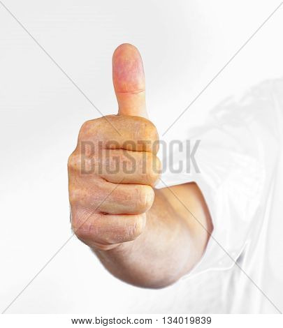 Hand gesturing the all right symbol isolated on white