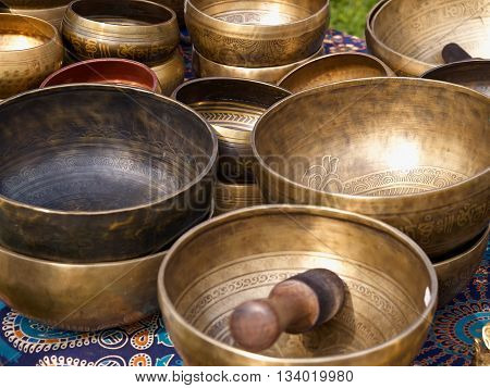 Tibetan singing bowls with batons in a traditional market Nepal