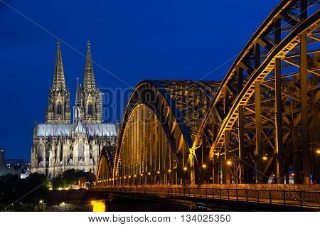 Photo of Cologne Cathedral and Hohenzollernbruecke at night