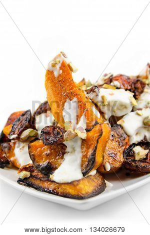 Butternut squash with slowly roasted tomatoes and pistachios.