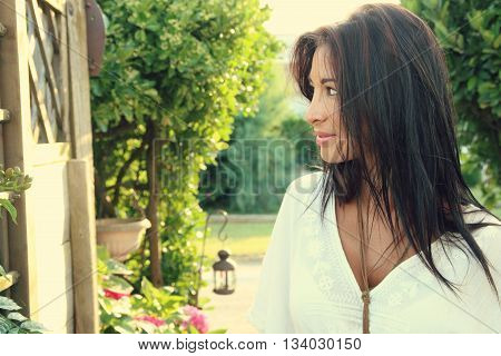 Beautiful woman with a boho style wearing a white tunic