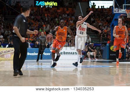 VALENCIA, SPAIN - JUNE 9th: Sato with ball and Llull during 4th playoff match between Valencia Basket and Real Madrid at Fonteta Stadium on June 9, 2016 in Valencia, Spain
