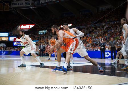 VALENCIA, SPAIN - JUNE 9th: Dubljevic with ball and Ayon during 4th playoff match between Valencia Basket and Real Madrid at Fonteta Stadium on June 9, 2016 in Valencia, Spain