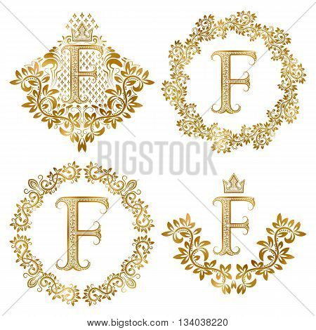Golden letter F vintage monograms set. Heraldic monogram in coats of arms form letter F in floral round frame letter F in wreath heraldic monogram in floral decoration with crown.