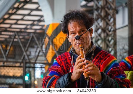 TOKYO JAPAN - NOVEMBER 26 2015: Unidentified group of Peruvian Street Musicians perform traditional music for people at Uneno station
