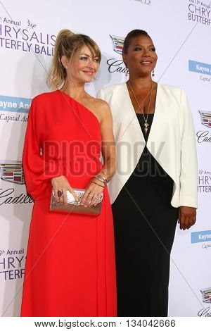 LOS ANGELES - JUN 11:  Rebecca Gayheart, Queen Latifiah at the 15th Annual Chrysalis Butterfly Ball at the Private Residence on June 11, 2016 in Brentwood, CA