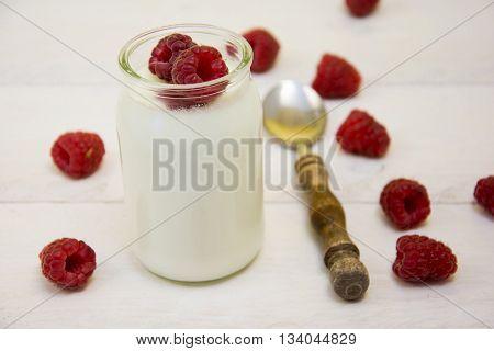 Two White Yogurt With Rasperries