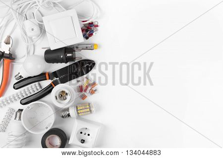 top view of electrical tools and equipment on white