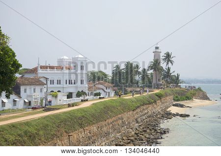 GALLE, SRI LANKA - MARCH 22, 2015: View of the building of the mosque and the lighthouse. Main landmark of the city Galle, Sri Lanka