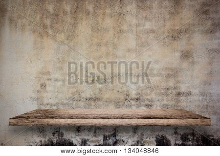 Empty wooden shelf with old concrete wall background. For display or montage your products.
