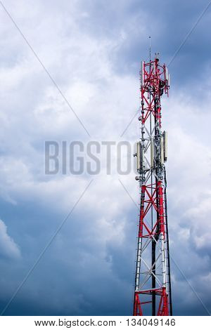 Mobile phone network GSM communication repeater antenna against cloudy sky