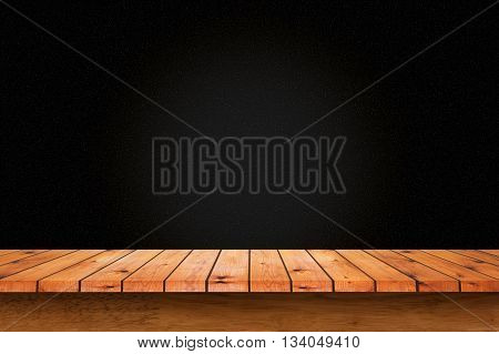 Empty wooden table with black wall background. For display or montage your products