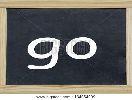 close up of go written on a chalkboard