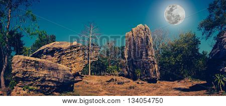 Panorama Of Boulders Against Beautiful Sky And Full Moon Over Tranquil Nature. Cross Process And Vin