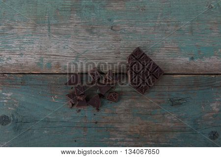 Dark chocolate on old vintage table stock photo