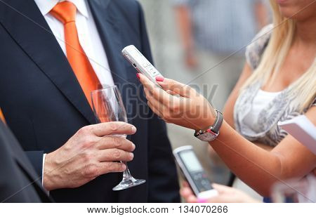Press interview. Journalist making media interview with businessman.