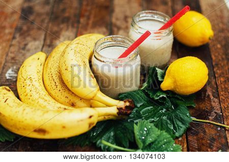 Fruit Smoothies. Banana Smoothies With Milk. Banana Smoothie On A Wooden Table. Healthy Breakfast: B