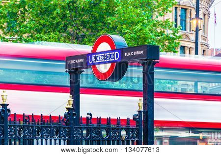 London UK - June 7 2016 - Underground sign and double decker in motion at Charing Cross