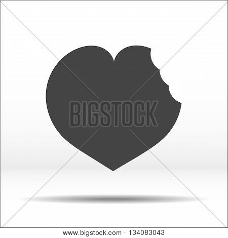 Grey heart with a bite mark on it. White-black illustration and icon.