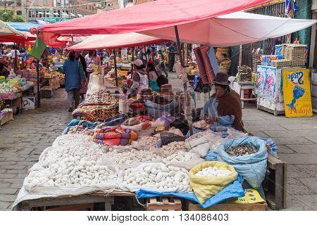 La Paz, Bolivia - October 24, 2015: Woman selling vegetable on the street market.