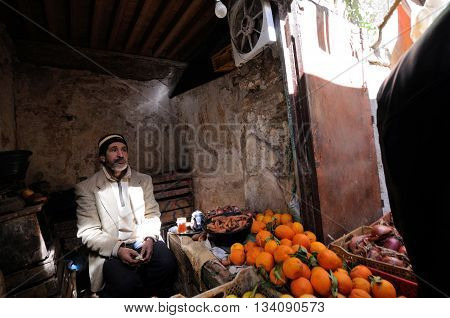 FES - MARCH 10: Unknown man trades a fruits in a Market (souk) in a city Fes in Morocco. The market is one of the most important attractions of the city. March 10, 2012 Fes, Morocco.