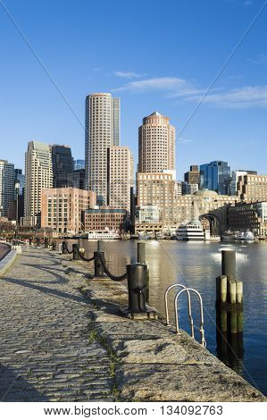 Vertical format early morning view of Rowes Wharf from Fan Pier on Boston's Harborwalk