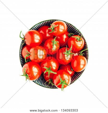 Bowl of red tomatoes on white background. High angle photo