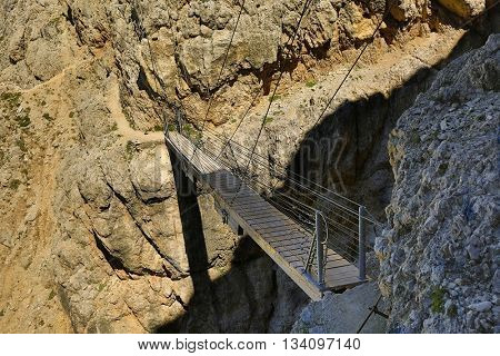 Hiking route through a bridge in the Alps
