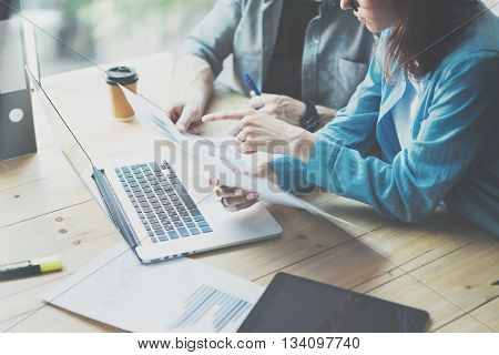 Sales Department Work Process.Photo traders reading market report modern laptop.Using electronic devices.Working graphics, stock exchanges data reports.Business project startup.Horizontal, film effect.