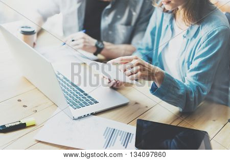 Account team discussion process.Business crew working with new startup project.Notebook, tablet wood table, using devices.Creative Idea presentation.Analyze market stock.Blurred background, film effect