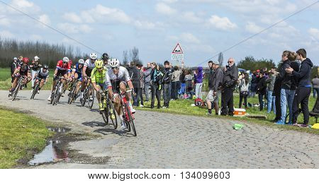 Hornaing France - April 10,2016: The peloton including the biggest favorites Peter Sagan and Fabian Cancellara riding on a paved road in Hornaing France during Paris Roubaix on 10 April 2016.