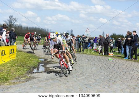 Hornaing France - April 10,2016: The peloton including the biggest favourites Peter Sagan and Fabian Cancellara riding on a paved road in Hornaing France during Paris Roubaix on 10 April 2016.