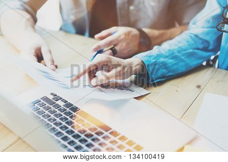 Sales Managers Working Modern Studio.Woman Showing Hand Market Report Charts.Marketing Department Planning New Strategy.Researching Process Wood Table.Horizontal.Blurred Background.Film effect