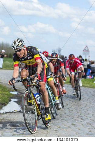Hornaing France - April 10,2016: The Belgian cyclist Preben Van Hecke of Direct Energie Team riding in the peloton on a paved road in Hornaing France during Paris Roubaix on 10 April 2016.