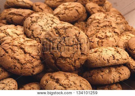 Cookies background. Sweet oatmeal homemade biscuits and cookies texture background. Oatmeal cookies closeup. Dessert, sweets for tea. Fattening sweets concept