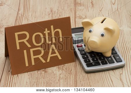 Having a Roth IRA plan A golden piggy bank card and calculator on wood background with text Roth IRA