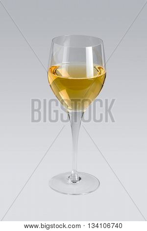 wine glass partly filled with white wine in grey back