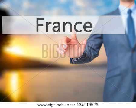 France - Businessman Hand Pressing Button On Touch Screen Interface.