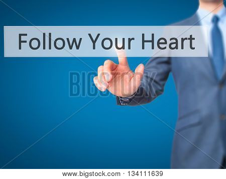 Follow Your Heart - Businessman Hand Pressing Button On Touch Screen Interface.