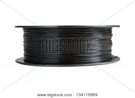 Filament for 3d printing. Black thermoplastic. Isolated on white background. Material produced from polylactic (pla) acid. One reels horizontal view. Macro, cutout. Concept of new technology for modeling and producing at home.