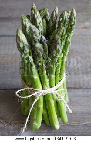 Green asparagus on wooden old boards closeup
